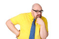 Portrait of thoughtful middle-aged man in a bright yellow dress. Royalty Free Stock Photo