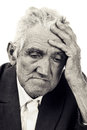 Portrait of a thoughtful old man on white black and white Stock Images