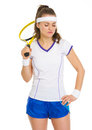 Portrait of thoughtful tennis player with racket isolated on white Royalty Free Stock Photography
