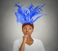 Portrait thoughtful woman colorful splashes coming from her head Royalty Free Stock Photo