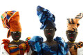 Portrait of three african dolls wearing head wraps colorful Stock Photo