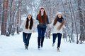 Portrait of three beautiful girls in winter park happy Royalty Free Stock Photo