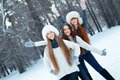 Portrait of three beautiful girls in winter park happy Stock Images