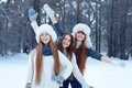 Portrait of three beautiful girls in winter park happy Royalty Free Stock Photography