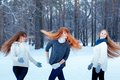 Portrait of three beautiful girls in winter park happy nice Stock Images