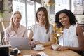 Portrait Of Three Businesswomen Meeting In Coffee Shop Royalty Free Stock Photo