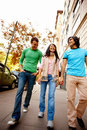 Portrait of three friends walking down the street Royalty Free Stock Images