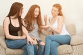 Portrait of three happy pretty young women at home Royalty Free Stock Photo