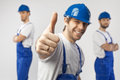 Portrait of three optimistic guys workers Royalty Free Stock Photo