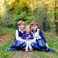 Portrait of three siblings children. Two kids brothers boys and little cute toddler sister girl having fun together in Royalty Free Stock Photo