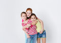 Portrait of three smiling girls at white studio background Royalty Free Stock Photo