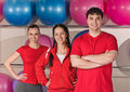 Portrait of three young sport people with fitness ball back Royalty Free Stock Photo
