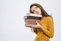 Portrait of a tired woman holding books Royalty Free Stock Photo