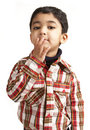 Portrait of a Toddler Blowing a Flying Kiss Stock Photos