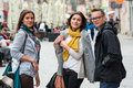 Portrait of traveling friends on shopping street cheerful group walking the city talking having fun laughing smiling happy Royalty Free Stock Photos