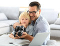 Portrait of trendy father with his son using camera Royalty Free Stock Photo