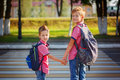 Portrait two adorable boys with backpack near pedestrian crossin Royalty Free Stock Photo
