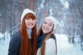 Portrait of two beautiful girls in winter park happy nice Royalty Free Stock Image