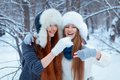 Portrait of two beautiful girls in winter park happy nice Stock Image