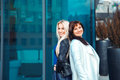 Portrait of two beautiful women blonde and brunette Royalty Free Stock Photo