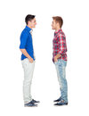 Portrait of two brothers face to face isolated on a white background Stock Image