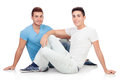 Portrait of two brothers sitting isolated on a white background Royalty Free Stock Photo