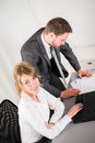Portrait of two business people working together in office with computer men and women Royalty Free Stock Photo