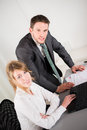 Portrait of two business people working together in office with computer men and women Royalty Free Stock Image