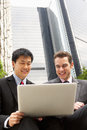 Portrait Of Two Businessmen Working On Laptop Royalty Free Stock Photography