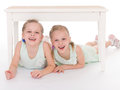 Portrait of two cheerful children close up lying at home happy family love and friendship concepts Royalty Free Stock Photography