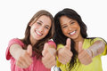 Portrait of two female students the thumbs-up Stock Photography