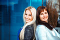 Portrait of two glamour ladies blonde and brunette looking at th Royalty Free Stock Photo