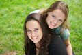 Portrait of two happy girls smiling outdoors closeup Royalty Free Stock Photos