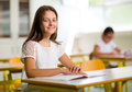 Portrait of two happy schoolgirls in a classroom Royalty Free Stock Photo