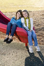 Portrait of two little girls on slide Stock Image
