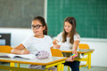 Portrait of two schoolgirls in a classroom. Royalty Free Stock Photo