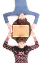 Portrait of two twins sisters with long hair and cork board Royalty Free Stock Photo