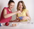 Portrait of two woman friends cooking women on white background Royalty Free Stock Image