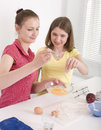 Portrait of two woman friends cooking women on white background Stock Photos