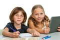Portrait of two young students at desk. Royalty Free Stock Photo