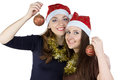 Portrait of two young women with christmas balls on white background Royalty Free Stock Image