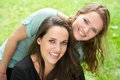 Portrait of two young women laughing outdoors closeup Stock Photos