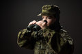 Portrait of unarmed woman with camouflage young female soldier observe with binoculars war military army people concept Stock Images