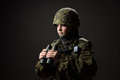 Portrait of unarmed woman with camouflage young female soldier observe with binoculars war military army people concept Stock Photos