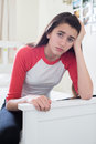 Portrait Of Stressed Teenage Girl In Bedroom Royalty Free Stock Photo