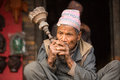 Portrait of unidentified Nepalese man smokes on the street Royalty Free Stock Photo