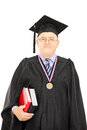 Portrait of a university dean in graduation gown posing isolated on white background Royalty Free Stock Photo