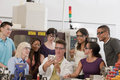Portrait of university engineering lab demonstrati smiling multiethnic students and instructors in a modern college laboratory Stock Photo