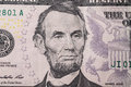 Portrait of US President Abraham Lincoln on the five dollar bill Royalty Free Stock Photo