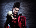 Portrait of a vampire lady holding a human skull Stock Photos